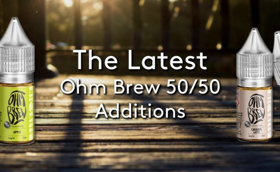 4 10ml bottles of the new Ohm Brew 50/50 balanced blends range, on a wooden decking with sun beaming through the fence