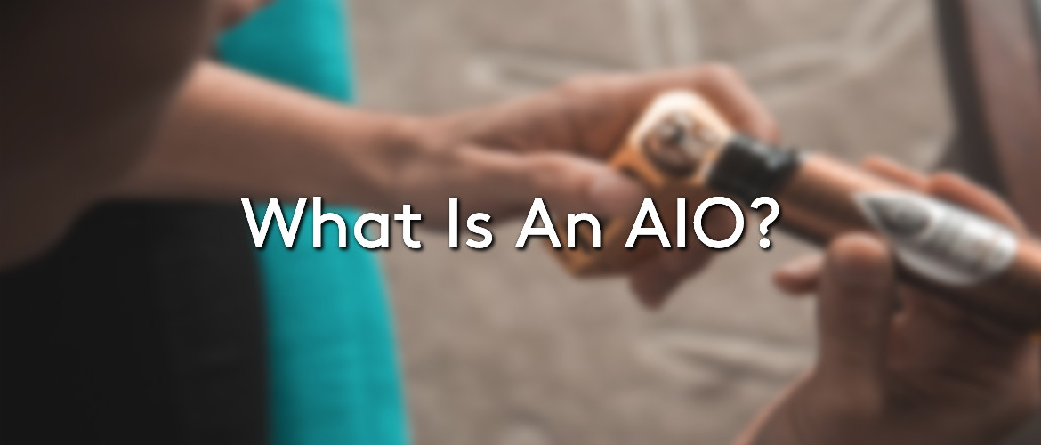 Blurry image of someone dripping e-liquid onto their RDA, with the title 'What is An AIO?'